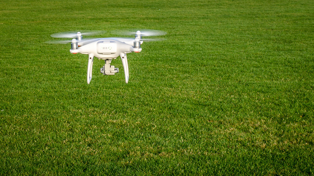 picture of surveying drone flying over grass