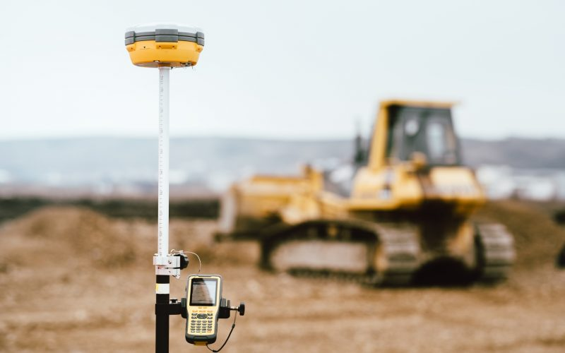Surveyor equipment GPS system outdoors at highway construction site. Surveyor engineering with surveying equipement