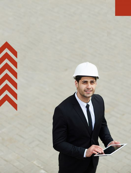 High angle portrait of handsome Middle-Eastern businessman wearing hardhat looking up at camera, copy space